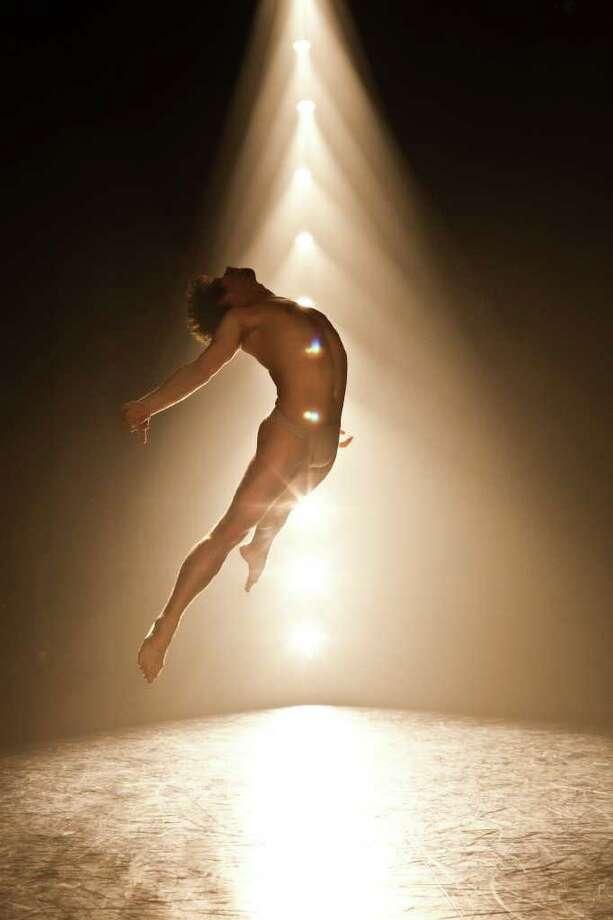 "Seth McPhail of NobleMotion Dance performing ""Splitting Night. Photo: Lynn Lane"