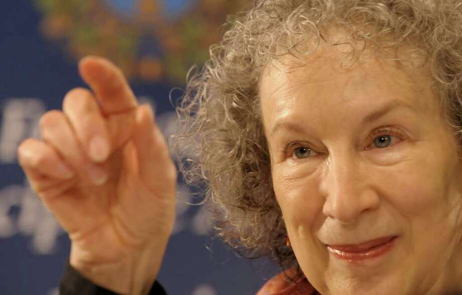 Canadian novelist Margaret Atwood gestures as she gives a press conference in Oviedo on October 22, 2008. Atwood has been awarded the 2008 Prince of Asturias Award for Letters.  AFP PHOTO / MIGUEL RIOPA (Photo credit should read MIGUEL RIOPA/AFP/Getty Images) Photo: MIGUEL RIOPA, Stringer / AFP
