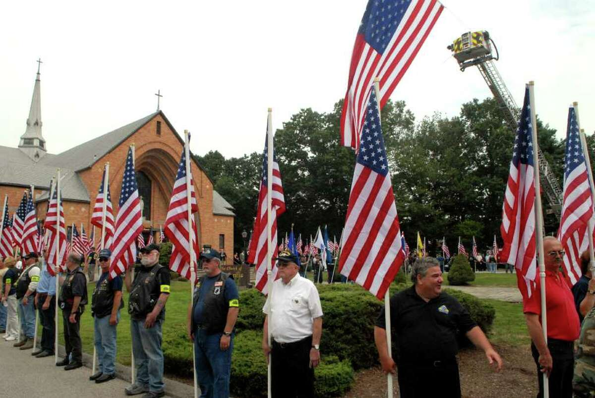 Members of the Patriot Guard stand outside the funeral of Chief Petty Officer Brian Bill, 31, a Navy SEAL from Stamford, at St. Cecilia Church in Stamford, Conn. on Friday August 19. 2011.