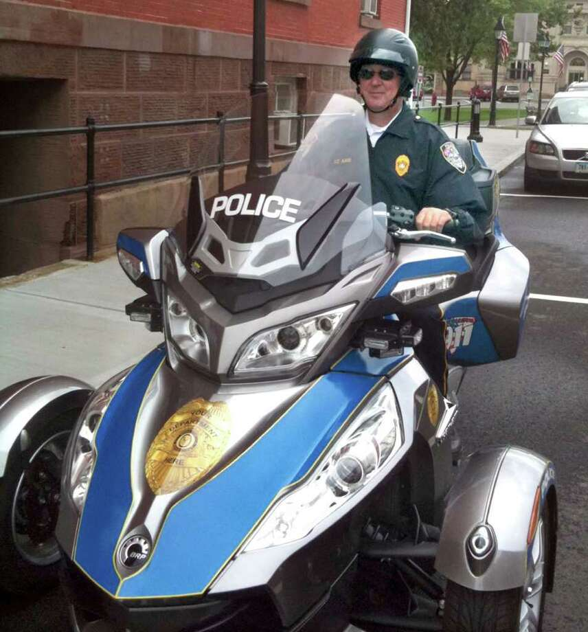 New Milford Police Lt. Larry Ash road tests a three-wheel police scooter donated for a trial run by Land Mí Sea in Waterbury, Ct. The scooter that has lights and siren can be used for traffic control, working with youth and downtown police patrols. The department at this time has no budget for such a vehicle at this time, but Police Chief Shawn Boyne thought it was worth  is investigating whether this $25,000 equipment might be of use in the future. Cheshire and Waterbury Police Departments currently have such scooters as part of their fleets.  Ash said it might be that a grant or benefactor could assist with such a purchase. He ode the scooter to Town Hall on Thursday afternoon and was planning to give Mayor Patricia Murphy a demonstration. Photo: Nanci Hutson
