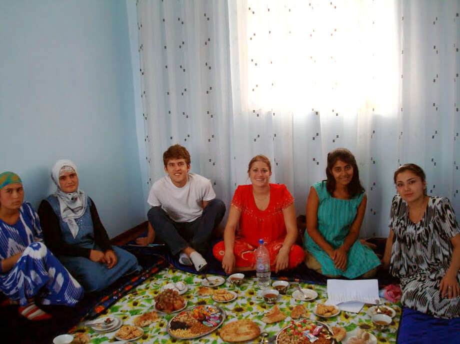 Ashley Pandya of Milford, second from right, is a guest at a traditional meal to mark the Islamic holiday of Eid e Ramazon, in a private home in Tajikistan. Pandya spent 10 months  in the Central Asian country on a Fullbright scholarship, teaching English to adults. Photo: Contributed Photo / Connecticut Post Contributed