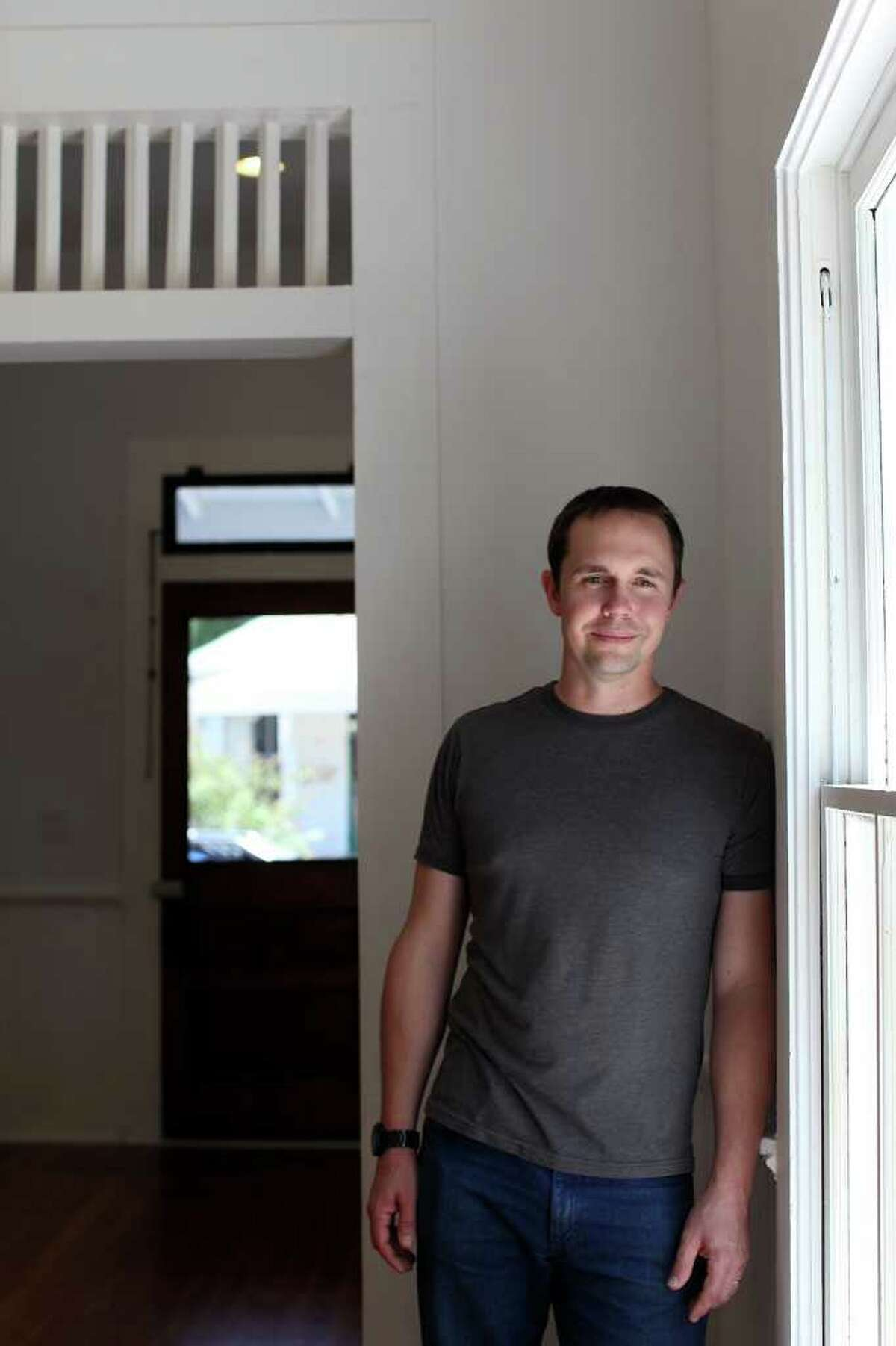 Metro - Josh Clapp stands in the dining room in the house he recently bought with his wife, Joanna Pierce, that was renovated by CVF Homes in the Lavaca neighborhood, in San Antonio on Thursday, August 11, 2011. LISA KRANTZ/lkrantz@express-news.net