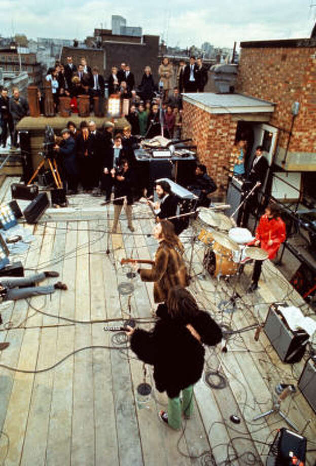 A 1969 photo shows the Beatles playing their final concert for a small audience on the roof of the Apple Records headquarters in London. Photo: Apple