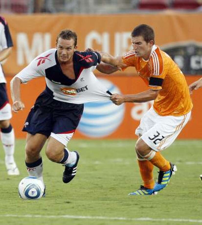 Defender Bobby Boswell, right, and the Dynamo remain in playoff contention with 10 regular-season games left. Photo: Bob Levey, Getty