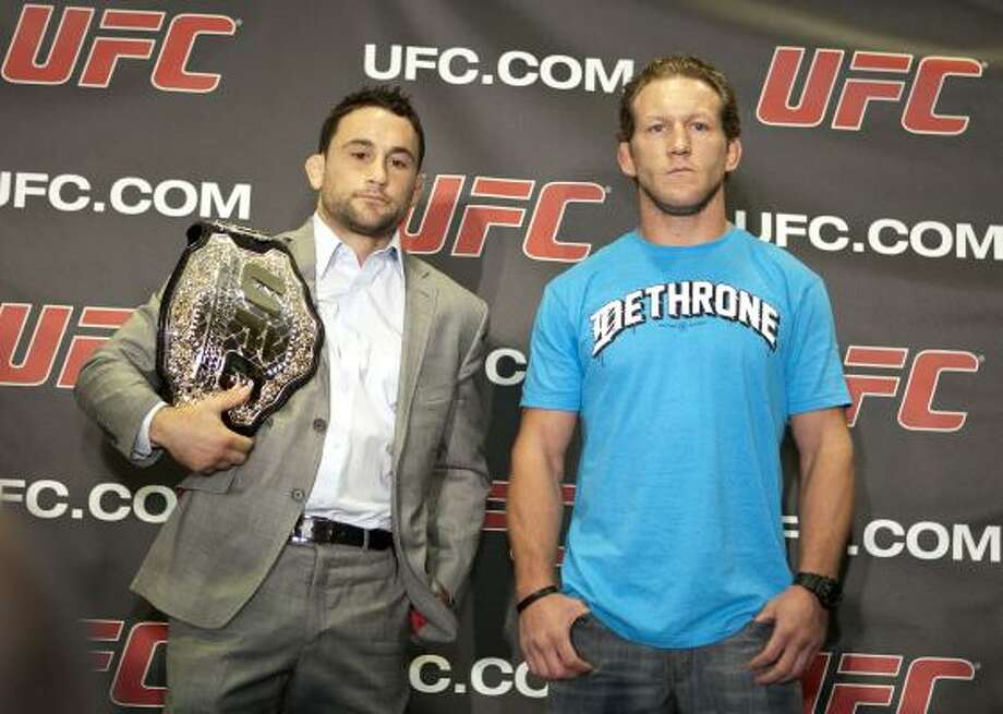 The only blemishes on the record of UFC lightweight champion Frankie Edgar, left, come from a loss and a draw against Gray Maynard, right. Photo: James Nielsen, Chronicle