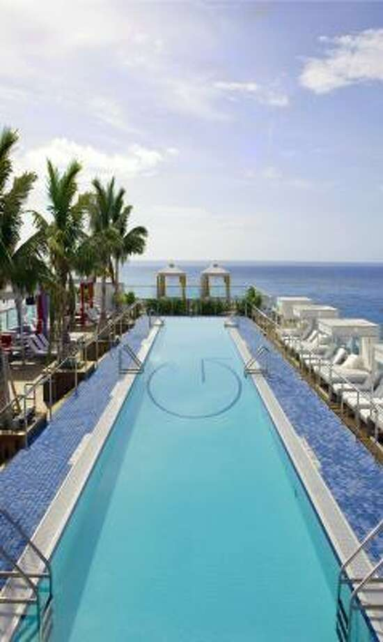 The rooftop pool at Gansevoort in Miami Beach is a cool place to lay in the sun. Photo: Gansevoort