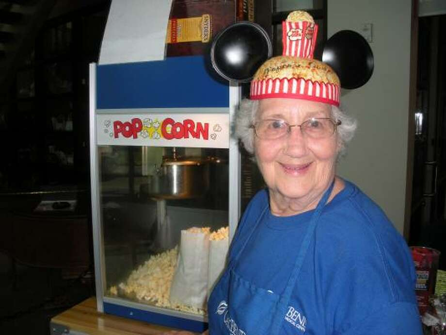 OakBend Medical Center volunteer Betty Humphrey serves popcorn to visitors. Photo: B.J. Pollock, For The Chronicle