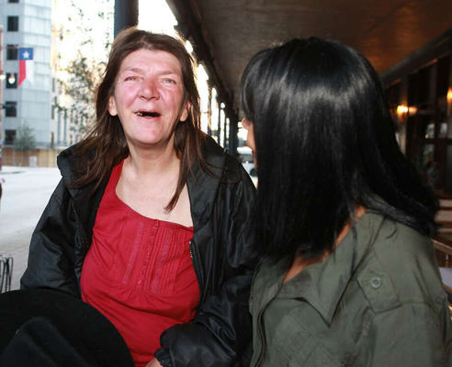 Jeannie Henry, 50, left, was able to talk to her sister on the phone in March for the first time in 25 years with the help of Judith Harris, right, a University of Houston-Downtown lecturer. Henry, who is homeless, is also struggling against alcohol abuse. Photo: James Nielsen, Chronicle