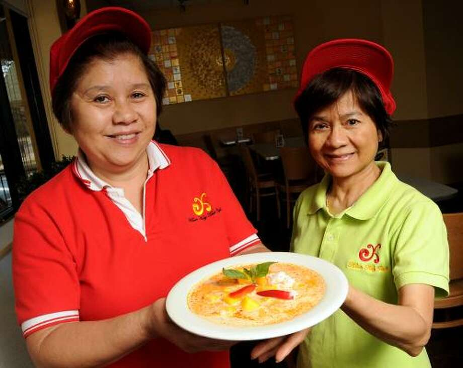 Co-owners chef Kay Soodjai and Supatra Yooto are proud of their mango curry dish at Khun Kay Thai Cafe on Montrose, but a shortage of Thai coconut milk is hurting the bottom line. The cost for a case of the ingredient has doubled. The sisters in law have sold the restaurant to new owners who are assuming the business Jan. 1, 2016. Photo: Dave Rossman, Chronicle