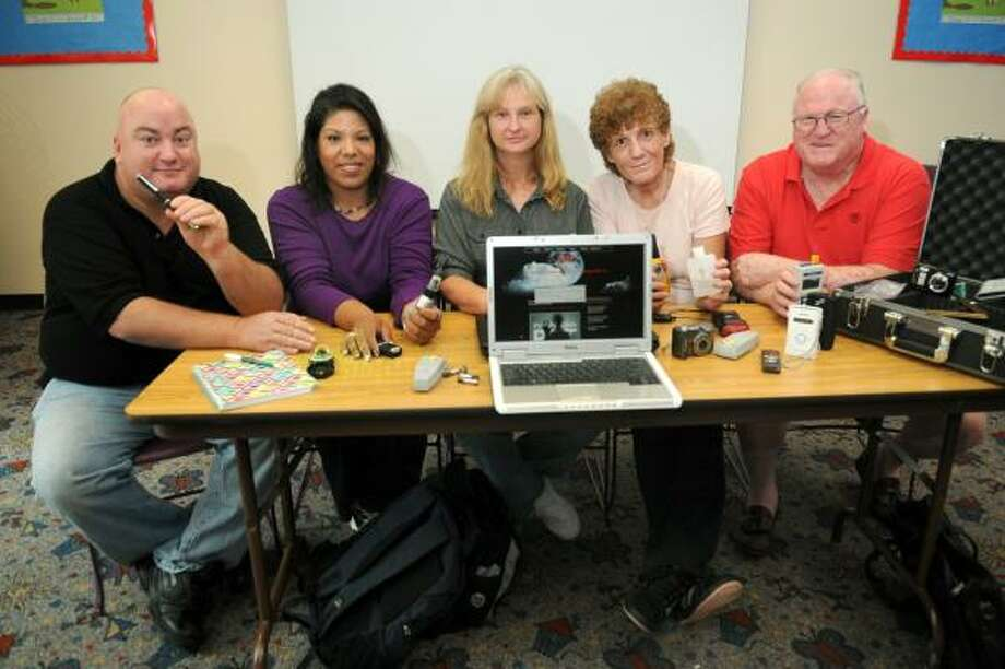 SPIRIT QUEST: Houston residents Glen Ruffin, left, and Christine Briones, Kristen Stout of Pasadena, Rodi Speake of Houston and Herb Day of La Marque are members of the Pasadena Paranormal Research Team. Newcomers are welcome. Photo: Jerry Baker, For The Chronicle