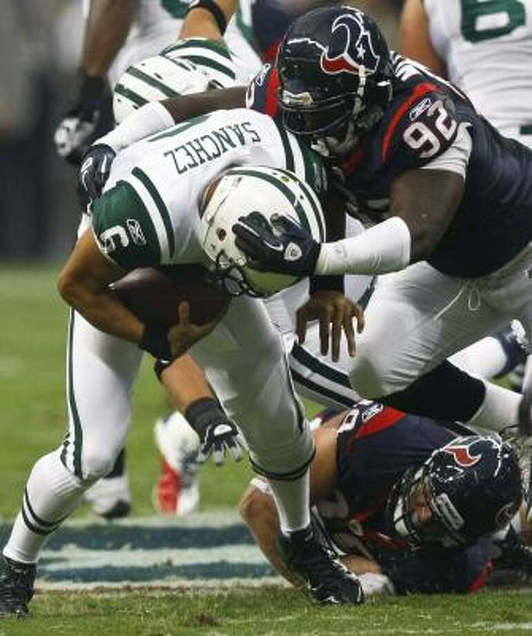 Texans defensive tackle Earl Mitchell started a trend of sacking the quarterback. Photo: Michael Paulsen, Chronicle