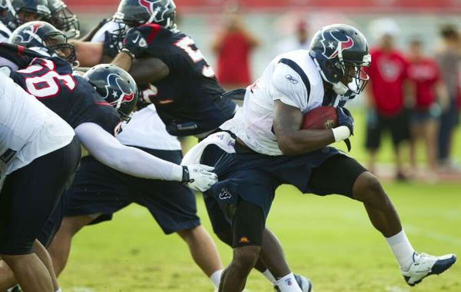 Houston Texans running back Ben Tate (44) breaks away from  defensive end Zane Parr (66) as he runs the ball during Texans training camp at the Methodist Training Center Wednesday, Aug. 3, 2011, in Houston.  ( Brett Coomer / Houston Chronicle ) Photo: Brett Coomer, Houston Chronicle