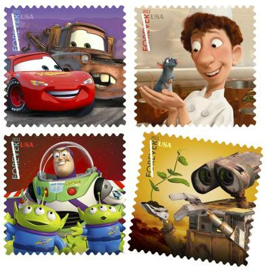 New stamps featuring characters from movies made by Pixar Animation Studios and Walt Disney include (clockwise from top left), Lightning McQueen and Mater from Cars, Remy the rat and Linguini from Ratatouille, Wall-E the robot from Wall-E and Buzz Lightyear from Toy Story. Photo: U.S. Postal Service