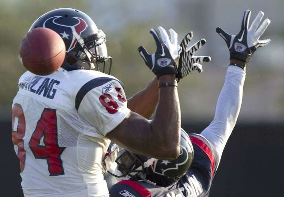 Texans wide receiver Devard Darling drops a pass with cornerback Brice McCain defending. Photo: Brett Coomer, Chronicle