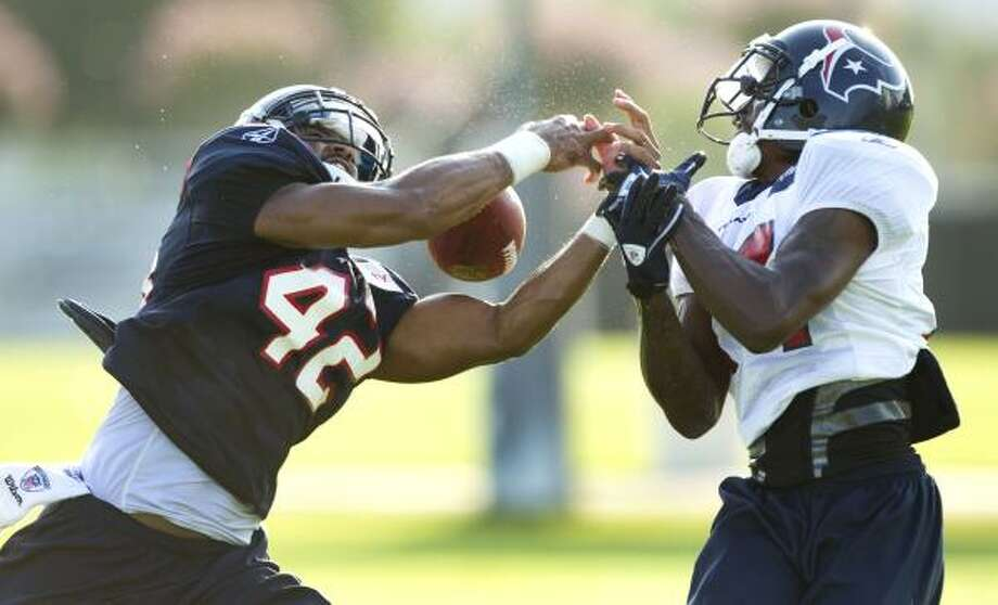 Aug. 18Texans safety Torri Williams breaks up a pass intended for wide receiver Derrick Townsel. Photo: Brett Coomer, Chronicle