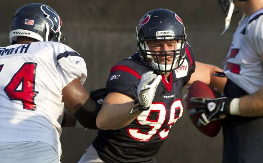 Texans defensive end J.J. Watt rushes the passer while working against center Wade Smith. Photo: Brett Coomer, Chronicle