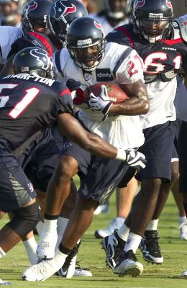 Texans running back Chris Ogbonnaya cuts back in front of linebacker Darryl Sharpton. Photo: Brett Coomer, Chronicle