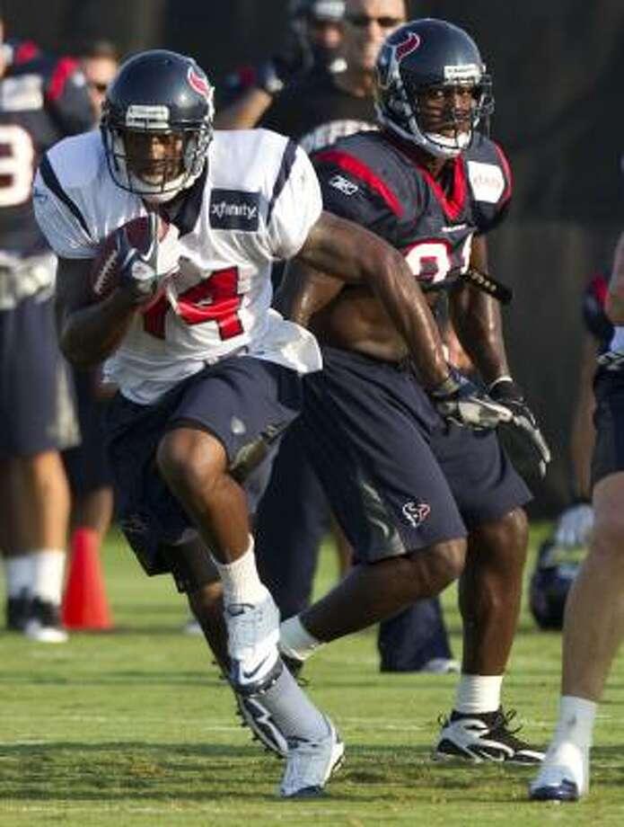 Texans running back Ben Tate runs the ball past  linebacker Tim Dobbins. Photo: Brett Coomer, Chronicle