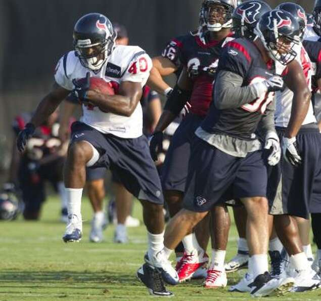 Texans running back Javarris Williams runs the ball past linebacker Connor Barwin.
