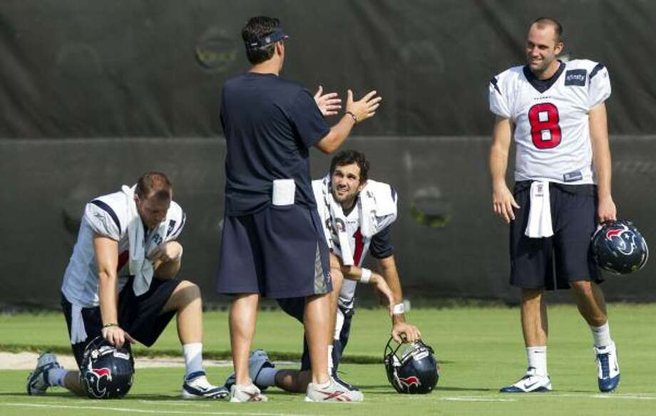 Texans quarterbacks coach Greg Knapp talks to quarterbacks T.J. Yates (13), Matt Leinart (11) and Matt Schaub (8). Photo: Brett Coomer, Chronicle