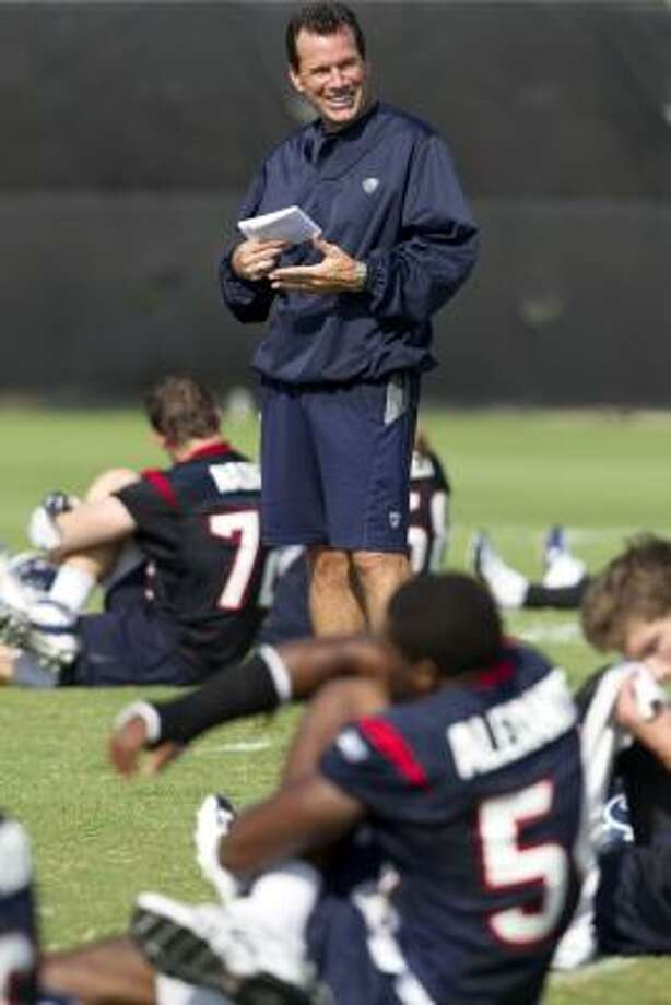 Texans head coach Gary Kubiak smiles as he watches his players stretch at the end of practice. Photo: Brett Coomer, Chronicle