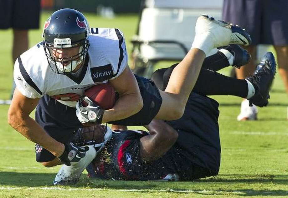 Aug. 17 Texans tight end Joel Dreessen dives over cornerback Glover Quin. Photo: Brett Coomer, Chronicle