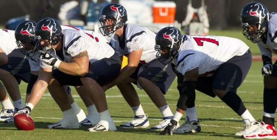 Texans quarterback Matt Schaub lines up under center Chris Myers. Photo: Brett Coomer, Chronicle