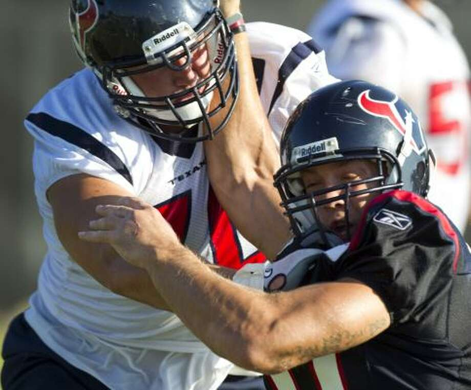 Texans tackle Cole Pemberton blocks linebacker Bryan Braman. Photo: Brett Coomer, Chronicle