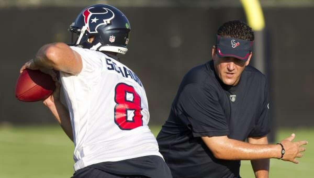 Texans quarterback Matt Schaub dodges past quarterbacks coach Greg Knapp in 2011.