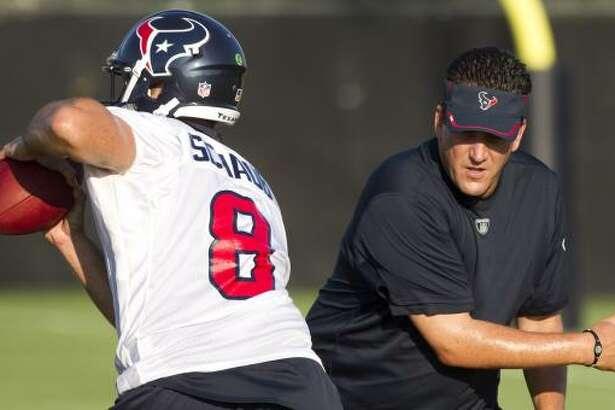 Texans quarterback Matt Schaub dodges past quarterbacks coach Greg Knapp.