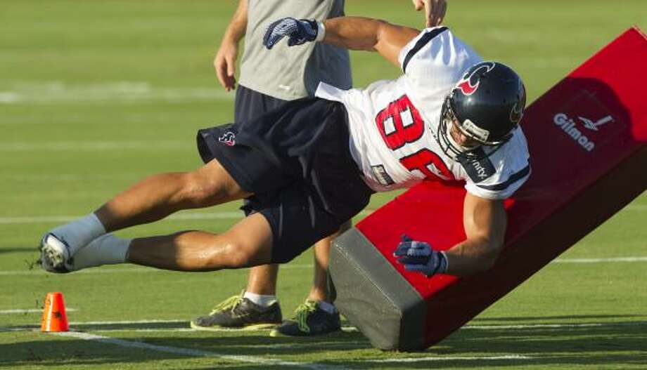 Texans tight end James Casey hits a blocking dummy. Photo: Brett Coomer, Chronicle