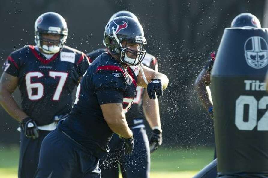 Texans defensive tackle Shaun Cody runs through a drill.