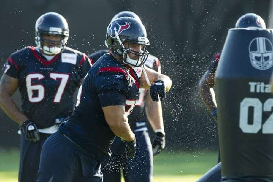 Texans defensive tackle Shaun Cody runs through a drill. Photo: Brett Coomer, Chronicle