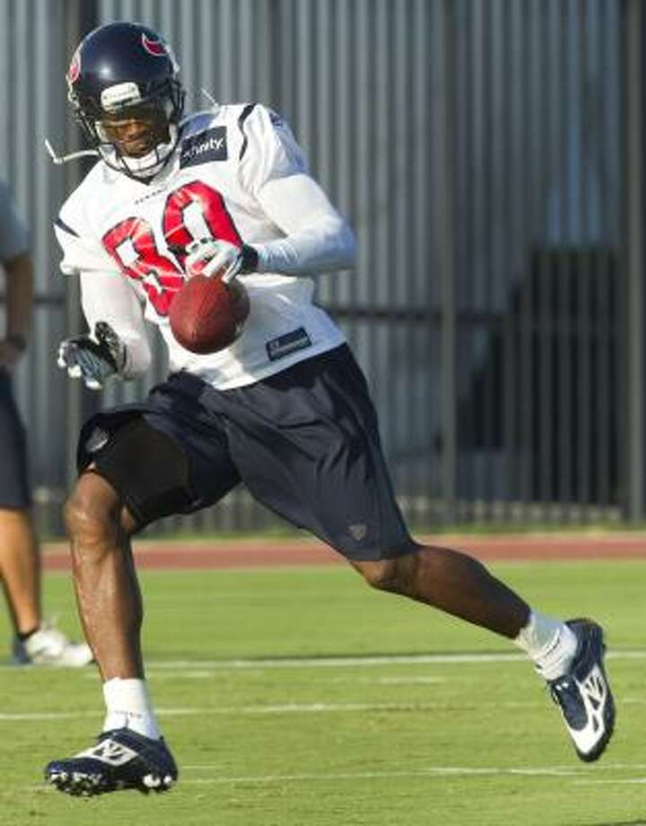 Texans wide receiver Andre Johnson corrals a ball. Photo: Brett Coomer, Chronicle