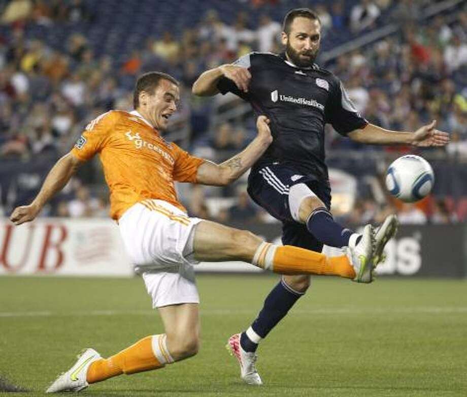 Aug. 17: Dynamo 1, Revolution 1 Dynamo forward Cam Weaver, left, makes an attempt at goal as New England Revolution defender Ryan Cochrane, right, defends. Photo: Elise Amendola, Associated Press