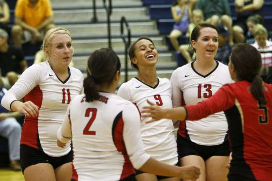 Aug. 16: Cypress Woods 3, College Park 0 Cypress Woods players celebrate a point during their win against College Park on Tuesday night. Photo: Michael Paulsen, Chronicle