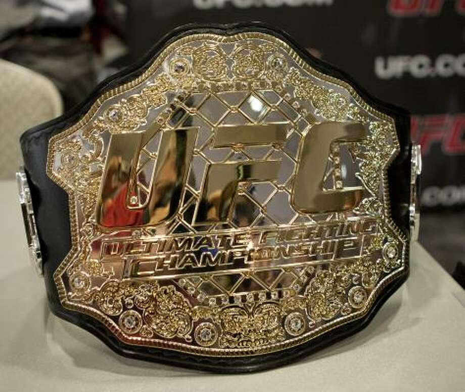 A UFC championship belt sits on a table at the press conference for UFC 136 which will be held at Toyota Center on Oct. 8. Two titles will be on the line at UFC 136. Photo: James Nielsen, Chronicle