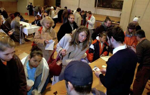 "Hopeful actors submit their forms and photos to casting agents in the Athens Community Center  for an upcoming filming of a motion picture entitled ""War of the Worlds"", Saturday morning, Nov. 13, 2004 (Steve Jacobs / Times Union) Photo: STEVE JACOBS, AP Photo / TU"
