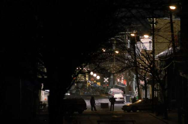 "Preparations continue on a  barricaded  closed Second Street in Athens, NY Monday evening Dec. 6, 2004, as preparations for filming ""War of the Worlds"" on the riverfront are made for later in the night. (Philip Kamrass /  Times Union) Photo: PHILIP KAMRASS, AP Photo / ALBANY TIMES UNION"