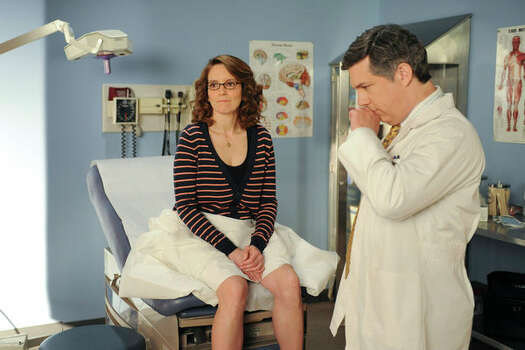 "30 ROCK -- ""Respawn"" Episode 523 -- Pictured: (l-r) Tina Fey as Liz Lemon, Chris Parnell as Dr. Leo Spaceman (Ali Goldstein / NBC) Photo: Ali Goldstein, AP Photo / © NBCUniversal, Inc."
