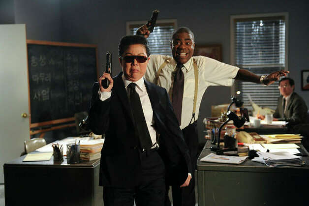 "30 ROCK -- ""Everything Sunny All The Time Always"" Episode 522 -- Pictured: (l-r) Margaret Cho as Kim Jong-Il, Tracy Morgan as Tracy Jordan (Ali Goldstein / NBC) Photo: Ali Goldstein, AP Photo / © NBCUniversal, Inc."