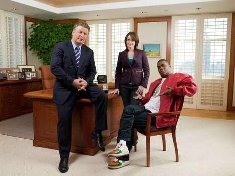 "This 2006 photo, provided by NBC TV, shows the stars of the network's hit comedy series ""30 Rock,"" from left, Alec Baldwin as Jack Donaghy, Tina Fey as Liz Lemon and Tracy Morgan as Tracy Jordan. Photo: Mitchell Haaseth, AP Photo / AP2006"