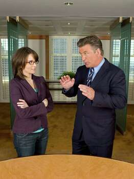 "This undated promotional photo, provided by NBC Universal, shows Tina Fey and Alec Baldwin in the new NBC comedy series ""30 Rock."" Photo: MITCHELL HAASETH, AP Photo / AP2006"