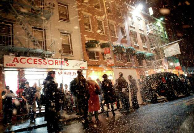 "A fake snowstorm blows in on a warm, 67 degree evening during filming for an upcoming episode of HBO's ""The Sopranos"" on Mulberry Street in Manhattan's Little Italy neighborhood Wednesday, March 14, 2007 in New York. Photo: Jason DeCrow, AP Photo / AP2007"