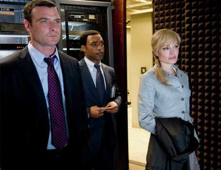 "In this film publicity image released by Columbia Pictures, from left, Liev Schreiber, Chiwetel Ejiofor and Agelina Jolie are shown in a scene from ""Salt."" Photo: Andrew Schwartz, AP Photo / AP2009"