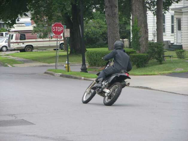 "Ryan Gosling rides a motorcycle during  filming of ""The Place Beyond the Pines"" on Friday, July 29. The day's filming was being carried out outside the First National Bank of Scotia branch in Scotia. (Desiree LaBombard / Special to the Times Union) Photo: AP Photo"