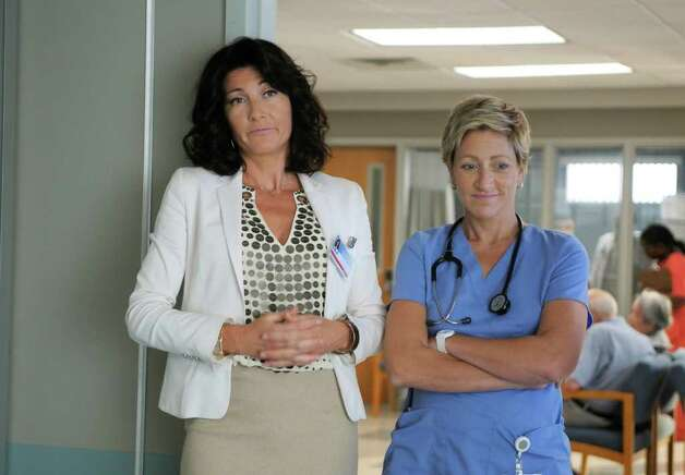 "In this publicity image released by Showtime, Eve Best stars as Dr. O'Hara, left, and Edie Falco as Jackie Peyton in the Showtime original series, ""Nurse Jackie."" Photo: Phil Caruso, AP Photo / AP2009"