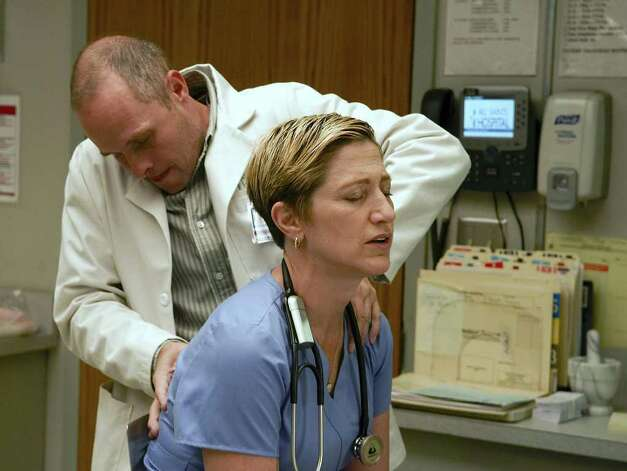 "In this TV publicity image released by Showtime, Paul Schulze portrays Eddie, left, and Edie Falco portrays Jackie Peyton in a scene from the Showtime original series, ""Nurse Jackie."" Photo: Ken Regan, AP Photo / AP2008"