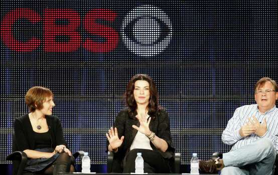 "Creators and executive producers: Michelle King, left, and Robert King, far right, take questions about their show ""The Good Wife,""  with actress Julianna Margulies, during the CBS portion of the 2011 Winter Television Critics Association press tour Jan. 14, 2011 in Pasadena, Calif. Photo: Damian Dovarganes, AP Photo / AP2011"