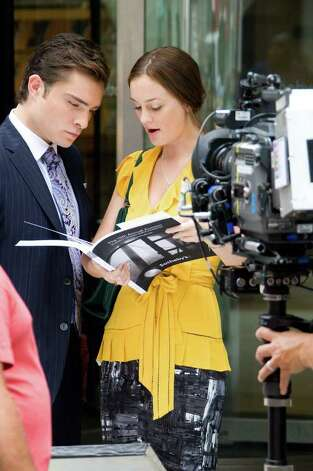 "Actors Ed Westwick and Leighton Meester film a scene for ""Gossip Girl"" in New York, Wednesday, July 22, 2009. Photo: Charles Sykes, AP Photo / AP2009"